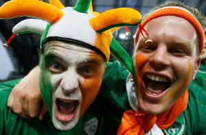 Ireland fans with their faces painted in the Irish colours cheer