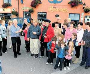 Frank Cooper and Arvid Moe celebrate their safe arrival in Portmagee, Co Kerry, yesterday