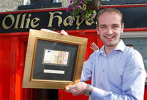 Henry Healy with the €50 note that the President Obama used to pay for a round of drinks in Ollie Hayes bar in Moneygall