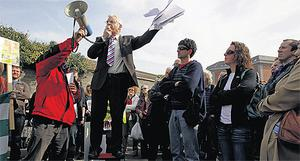TD Joe Higgins addresses demonstrators at yesterday's protest rally by the Campaign Against Household Tax. Photo. Julien Behal