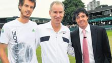 Rory McIlroy (R) meets Andy Murray (L) and former Wimbledon champion John McEnroe during his visit to SW19 yesterday