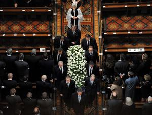 Jim Styne's coffin is carried out of the Cathedral. Photo: Getty Images