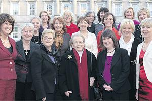 Joan Burton, left, with Labour women past and present. Only 25 out of the Dail's 166 TDs are women