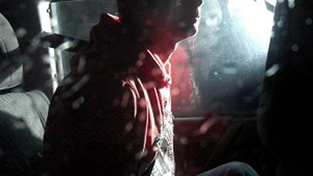 Damien Joseph McLaughlin, pictured being carried in a police car to an earlier hearing