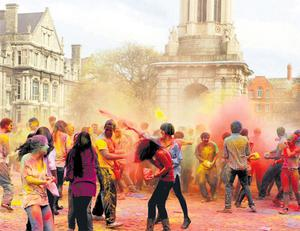 Trinity College students celebrate Holi, the Hindu festival of colours by throwing powdered paint all over each other in the front square.