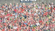 Kerry and Cork fans happily watch the Munster SFC final together at Fitzgerald Stadium in Killarmey last summer