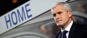 FILE PHOTO - QPR Manager Mark Hughes has been fired after a series of defeats leaving QPR sitting at the bottom of the Premier League table  LONDON, ENGLAND - APRIL 11:  Queens Park Rangers manager Mark Hughes looks on ahead of the Barclays Premier League match between Queens Park Rangers and Swansea City at Loftus Road on April 11, 2012 in London, England.  (Photo by Julian Finney/Getty Images)
