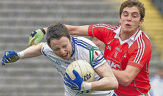 Monaghan's Eoin Duffy in action against Louth's Andy McDonnell during the league game which, after Monaghan won a DRA appeal, was played in Clones