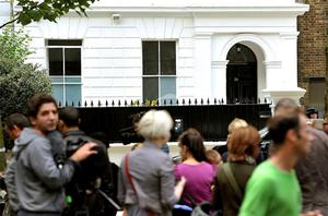 Fans gather outside the home of singer Amy Winehouse shortly after her death in 2011. Photo: PA