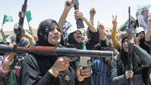 Libyan women chant pro-Gaddafi slogans when attending a weapons training session in the town of Bani Walid, some 200 km south east of Tripoli, back in June