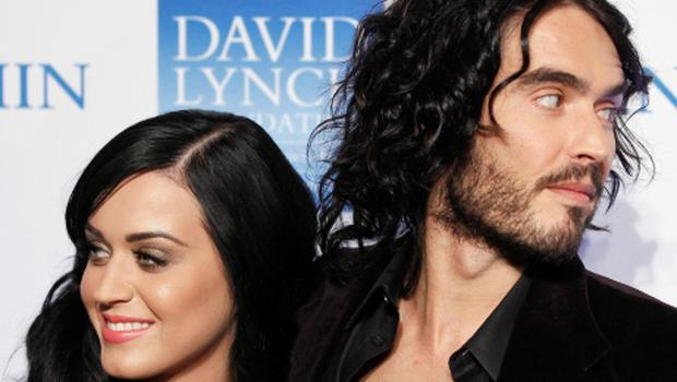 """Singer Katy Perry arrives with her husband, actor Russell Brand, for the annual David Lynch Foundation benefit celebration in New York in this December 13, 2010 file photograph. Brand filed for divorce on December 30, 2011 from Perry after just over a year of marriage. Brand, 36, star of the movie """"Get Him to the Greek"""", and """"California Gurls"""" singer Perry, 27, met in 2008 and married on October 23, 2010, becoming one of the most high-profile couples in the entertainment industry. REUTERS/Lucas Jackson/Files (UNITED STATES - Tags: ENTERTAINMENT)"""