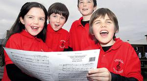 Aoife Maguire rehearsing with her brothers Oran, Conor and Cian of the Truagh Youth Choir in Monaghan.