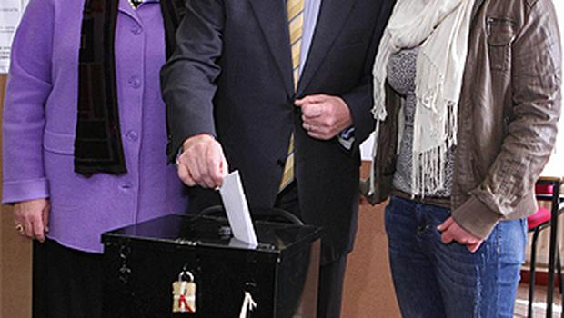 Fine Gael leader Enda Kenny casts his vote along with wife Fionnuala and daughter Aoibhinn at St Patricks National School in Castlebar, Co Mayo. Photo: PA