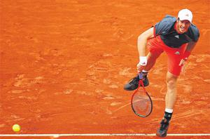 Andy Murray serves on his way to victory against Richard Gasquet at Roland Garros yesterday