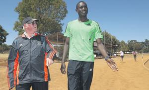 World-record holder David Rudisha walks with his coach Brother Colm O'Connell in Eldoret, Kenya earlier this year