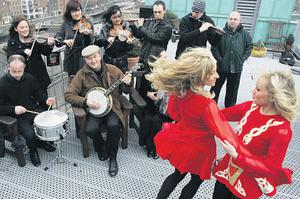 Dancers Fiona Stone and Mariam Elbadri with members of the Kilfenora Ceili Band in 2010