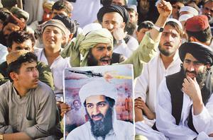 Supporters of al-Qa'ida leader Osama bin Laden in Quetta shout anti-American slogans after the news of his death