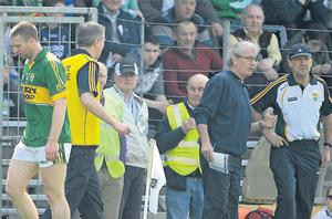 Kerry's Tomas O Se (left) leaves the field after being sent off by referee Marty Duffy as Kerry manager Jack O'Conor and selector Ger O'Keeffe discuss tactics at Fitzgerald Stadium yesterday