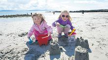 Aoife and Ciara Kelly from Salthill, Galway, above, enjoying the last of the good weather yesterday.