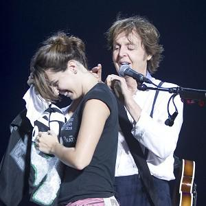 Sir Paul McCartney signs the neck of fan Natalia Lobo during his stadium concert in Recife, Brazil (2012 MPL Communications/AP)