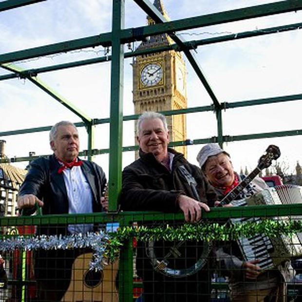 West Country music stars the Wurzels have toured London in a tractor