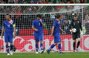 Croatia's Darijo Srna, Vedran Corluka, Ognjen Vukojevic and goalkeeper Stipe Pletikosa (L-R) react after the goal scored by Ireland's Sean St Ledger