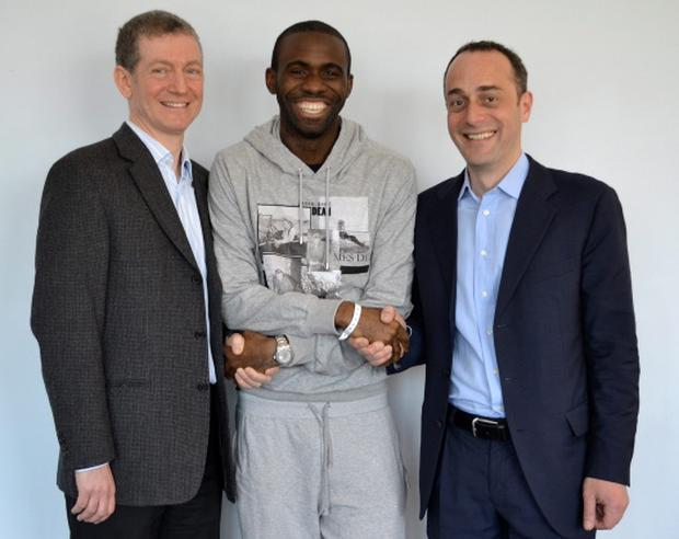 Bolton Wanderers footballer Fabrice Muamba (C) poses for a photograph with Dr Andrew Deaner (L) and Dr Sam Mohiddin in this undated photograph released by his premier league soccer club April 16, 2012. Bolton Wanderers midfielder Muamba, who suffered a cardiac arrest while playing at Tottenham Hotspur last month, was discharged from hospital in London on Monday. REUTERS/Bolton Wanderers/Handout (BRITAIN - Tags: SPORT SOCCER HEALTH) NO COMMERCIAL OR BOOK SALES. NO SALES. NO ARCHIVES. FOR EDITORIAL USE ONLY. NOT FOR SALE FOR MARKETING OR ADVERTISING CAMPAIGNS