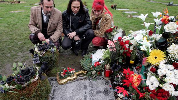Thin Lizzy fans from Sweden, l-r, Jalle Savqvist, Jocke Persson and Cilla Rorby, who travelled to Ireland yesterday to visit the grave in St Fintan's Cemetery, Sutton, Dublin