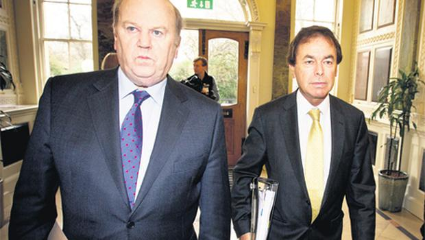 Finance Minister Michael Noonan and Justice Minister Alan Shatter arrive at Government Buildings in Dublin to unveil the Personal Insolvency Bill yesterday. Photo: Mark Condren