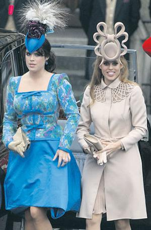 Princess Eugenie of York, left, and Princess Beatrice of York arrive to attend the royal wedding