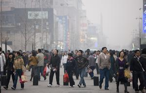 Crowded Wangfujing street and shops in Central Beijing, China. Photo: Getty Images