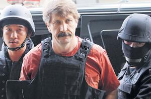 Russian arms smuggler Viktor Bout is escorted into court by members of the special police unit.
