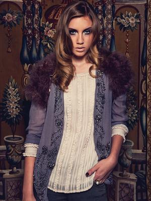 Grey embellished jacket, €50,threequarter- sleeve pintuck blouse, €30, and feather wrap, €45. Clothes a/wear