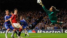 Edwin van der Sar - seen here making a save against Chelsea earlier this season is to captain Manchester United in his final Premier League game tomorrow
