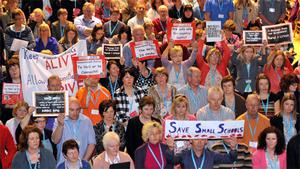 Delegates make their protest about small schools to Minister for Education Ruari Quinn as he addresses the INTO comnference in the Gleneagle Hotel, Killarney on Tuesday.
