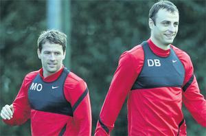 Michael Owen and Dimitar Berbatov in action at training yesterday