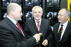 Former Taoiseach Bertie Ahern in 2006 with (left) Sean Gallagher, managing director of Smarthomes and star of 'Dragon's Den', and then Foreign Affairs Minister Dermot Ahern. Photo: Maxwells
