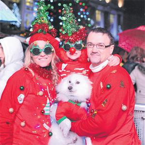 Frances and Mark Hyland, with their daughter Sarah and their dog Lucky, taking part in the Christmas jumper record attempt