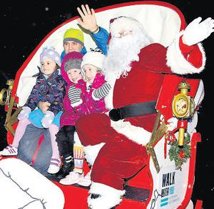 Lord Mayor of Dublin Naoise O Muiri, who turned on the Christmas tree lights in O'Connell Street, Dublin, with Santa and kids on his WALK sleigh, which helps raise awareness for people with intellectual disabilities