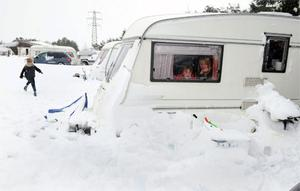 Families camping during school holidays get snowed in at Marfit Head farm near Pickering in North Yorkshire, as gale force winds, snow, sleet and rain which battered parts of Britain. Photo: PA