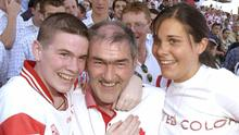 Michaela celebrates Tyrone's All-Ireland wins in 2003 with brother Matthew and dad Mickey. Photo: Sportsfile