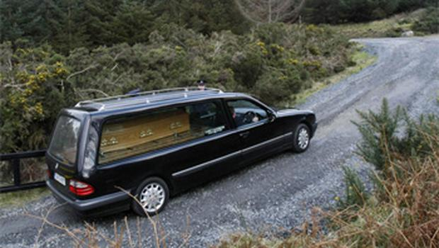A funeral car carrying the remains of Marioara Rostas from where they were found in the Wicklow mountains