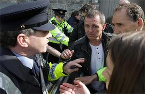 Gardai speaking to Richard Boyd Barrett TD, centre, after clashes with anti-austerity protestors at the Labour Party conference at NUI Galway