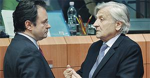 Greek finance minister George Papaconstantinou listens to European Central Bank (ECB) president Jean-Claude Trichet during the EU finance ministers meeting at the EU Council in Brussels yesterday