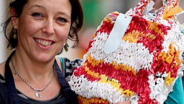 Polly Plouviez, manager of the Urban Larder, who is selling shopping bags made from knitted supermarket plastic carriers