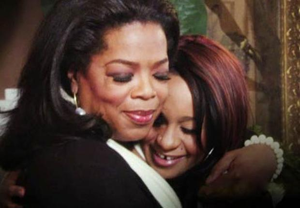 Bobbi Kristina is hugged by Oprah during their interview on the OWN network.