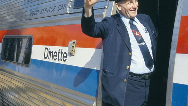 A conductor signals the departure from Wilmington