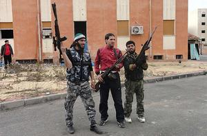 Members of Free Syrian Army hold their rifles as they stand in al-Bayada, Homs. Photo: Reuters