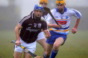 Galway's Andy Smith is pursued by DIT's Pat Hartley during their Walsh Cup quarter-final Ballinasloe yesterday. Photo: Ray Ryan / Sportsfile