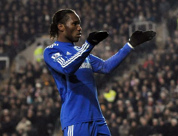 Chelsea's Didier Drogba celebrates after scoring from a free kick to equalise against Hull at the KC Stadium last night. Photo: Getty Images